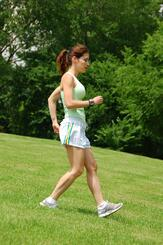 Woman Running Downhill
